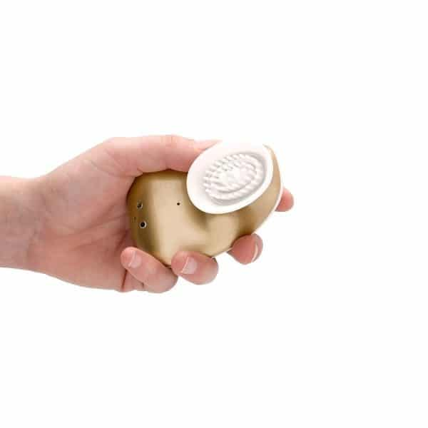 Twitch Gold Clitoral Suction & Vibrator in hand